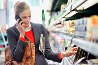 Woman in a supermarket talking on a mobile phone