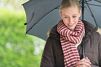 Close_up of a woman with an umbrella