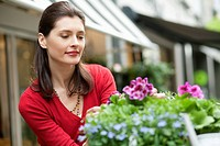 Woman looking at flowers in a flower shop