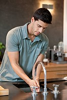 Man washing hands in the kitchen