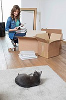 Woman looking at her cat and smiling (thumbnail)