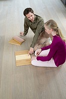 High angle view of a couple choosing laminated boards