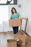 Woman carrying cardboard boxes (thumbnail)