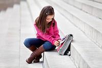 Girl opening her schoolbag