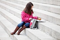 Girl taking out food from her schoolbag (thumbnail)
