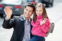 Man and his daughter waving hands