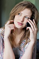 Close_up of a beautiful woman talking on a mobile phone