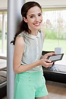Happy woman using an electronic book (thumbnail)