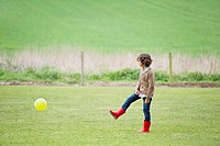 Boy playing with a ball in a field (thumbnail)
