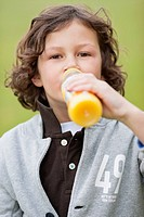 Portrait of a boy drinking juice
