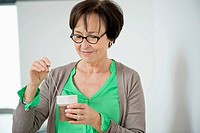 Close_up of a woman having coffee