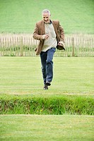 Man running in a field