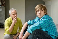 Man sitting with his son looking upset (thumbnail)