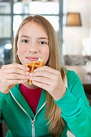 Portrait of a girl eating waffle