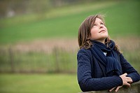 Girl looking up in a farm
