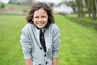 Portrait of a boy smiling in a field (thumbnail)