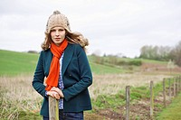 Portrait of a woman standing in a field (thumbnail)