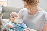 Baby girl feeding on milk with a milk bottle (thumbnail)
