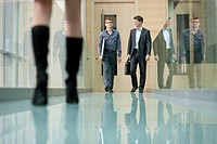 Business executives walking in a corridor