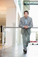 Businessman standing in an office corridor