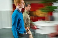 Businessmen walking in an office corridor