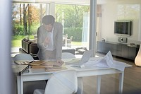 Interior designer working in the office (thumbnail)