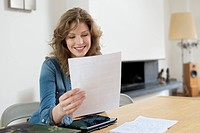 Woman sorting out bills