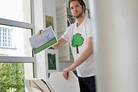 Man holding an ecological poster showing wind turbine (thumbnail)