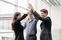 Business executives giving high_five to each other