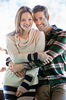 Portrait of smiling couple hugging (thumbnail)