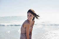 Smiling woman standing on sunny beach