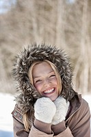 Portrait of smiling woman wearing fur hood coat