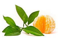 Juicy tangerine and leaves isolated on a white background.
