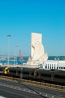 photo of a cityscape in Lisbon regarding the monumet of discoveries and April 25th bridge