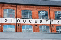 Gloucester sign/word on a typical English brick wall building