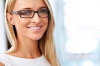 Portrait of beautiful smiling blonde with glasses on and copy space