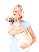 Beautiful blonde holding a Tibetan spaniel