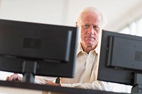 Senior professional working on computer