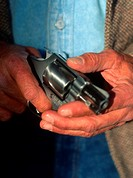 man holds 38 pistol