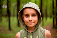 Kid with hood outdoors