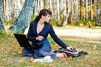 Businesswoman working on nature