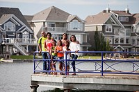 Family On A Pier In A Residential Lake Community, Edmonton Alberta Canada