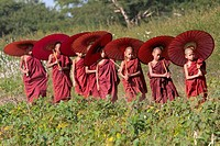 Myanmar, Burma  Bagan  Young Novice Monks with Umbrellas