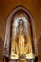 Myanmar, Burma  Bagan  Buddha Statue, Ananda Temple, teak covered with gold leaf  This is the Buddha on the east side of the temple, an 18th-century r...