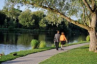 A man and a woman walk along the Avon River, Stratford, Ontario, Canada  A world famous Shakespeare Festival draws thousands of visitors here every ye...