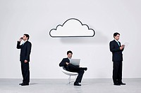 Businessmen using wireless devices with cloud computing network
