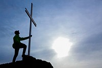 A man looks up at cross located at the top of mt. tzouhalem in the cowichan valley, british columbia canada