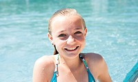 Smiling girl in swimming pool, portrait