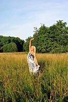 Blonde girl alone in field.