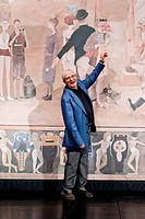 Jiri Suchy Czech novelist, poet, singer, musician and artist poses poses in front of thatre curtain he painted himself at the Semafor Theatre in Pragu...